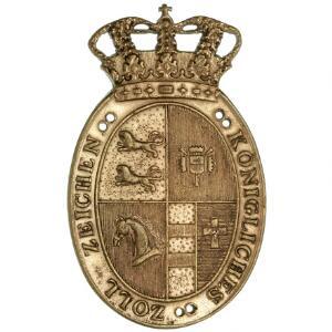 Königliches Zoll Zeichen - Kongeligt Toldtegn i ovalt messing med krone på toppen, 59 x 36 mm, med afbrækket holder på revers