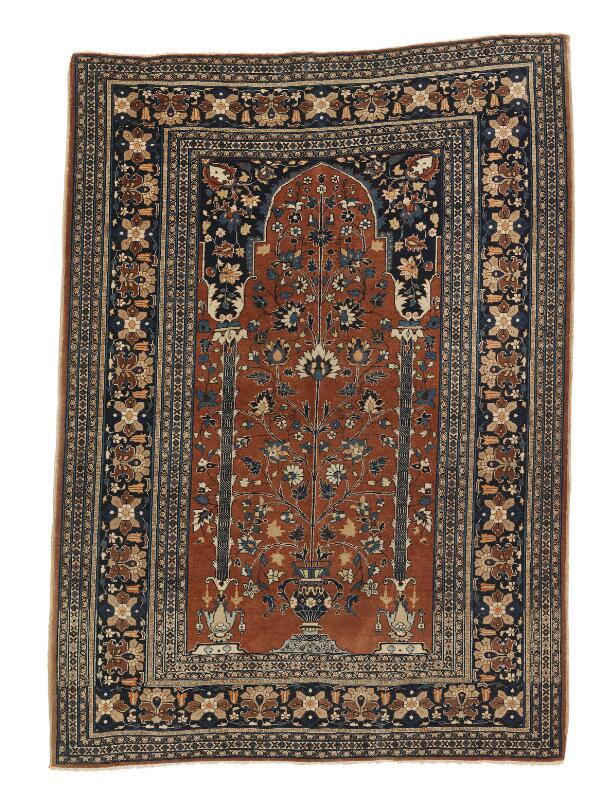 An antique Tabriz Haji Jalili rug, Persia. Flower vase design with arch and...