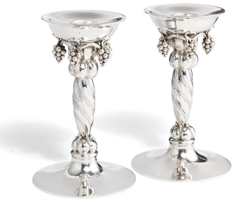 Georg Jensen: A pair of large sterling silver candlesticks with grapes...