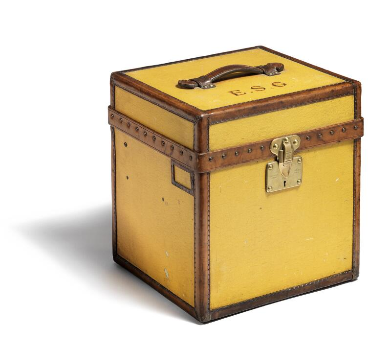Louis Vuitton: A hat box of treated yellow canvas with handle and...