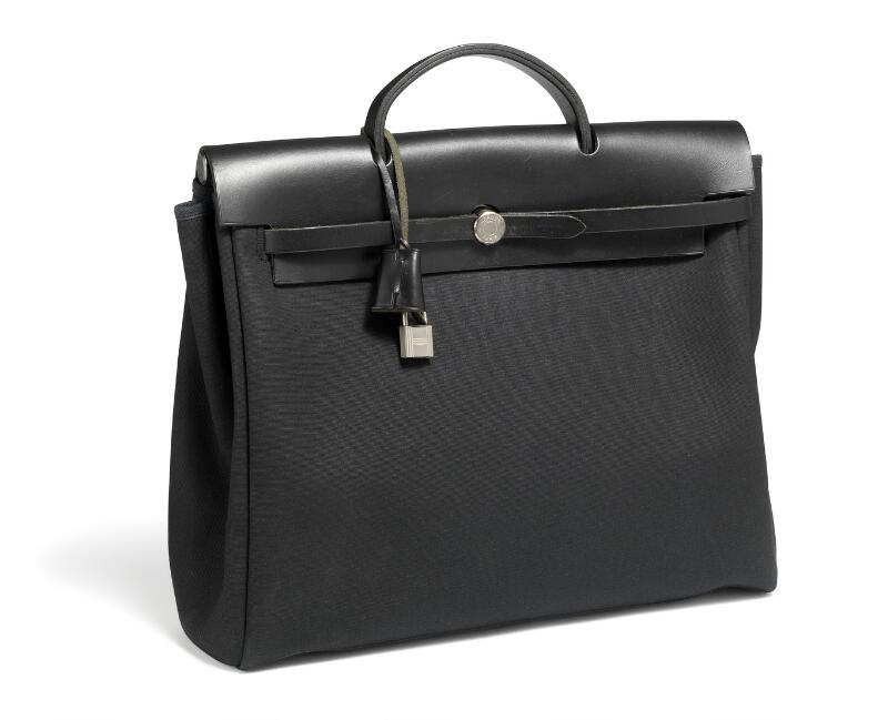 "Hermès: A ""Herbag officer"" bag of black canvas, leather and palladium..."