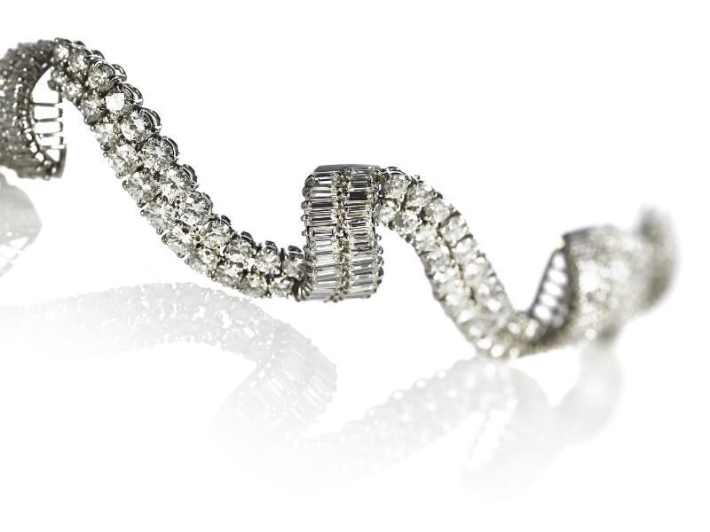 A diamond bracelet set with numerous brilliant and baguette-cut diamonds...