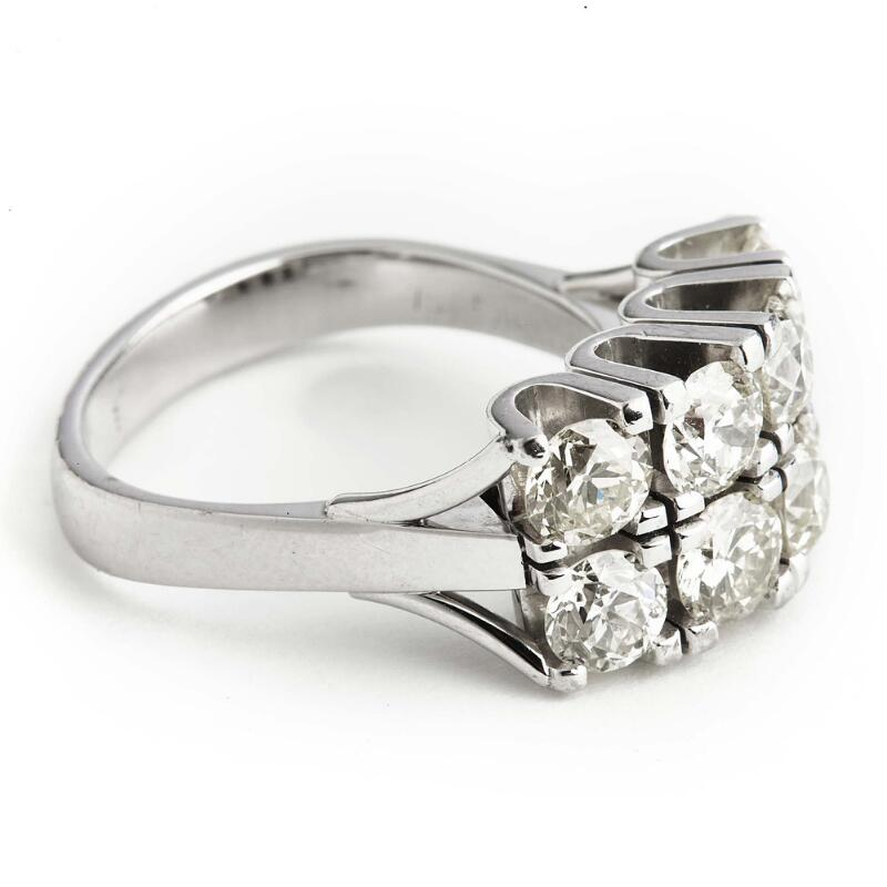 A diamond ring set with numerous old-cut diamonds weighing a total of app...