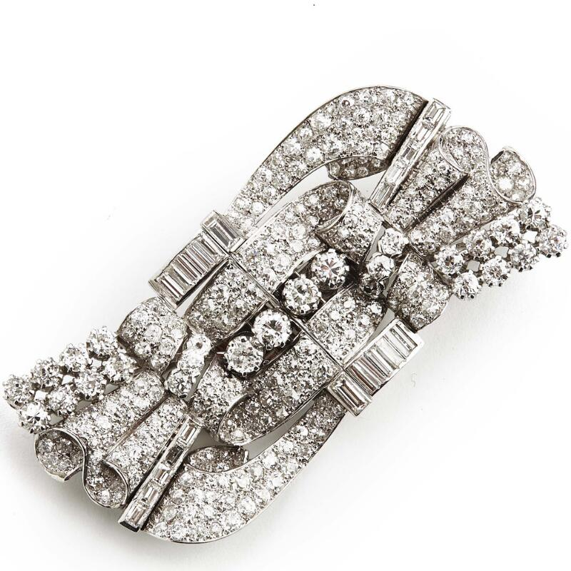 An Art Deco diamond double clip/brooch set with numerous brilliant and...