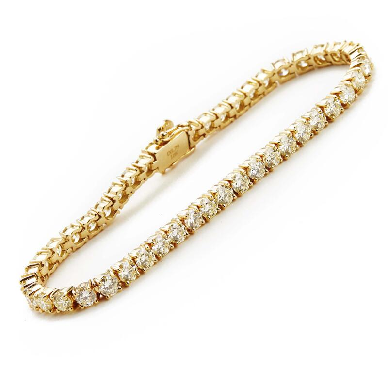 A diamond bracelet set with numerous brilliant-cut diamonds weighing a...