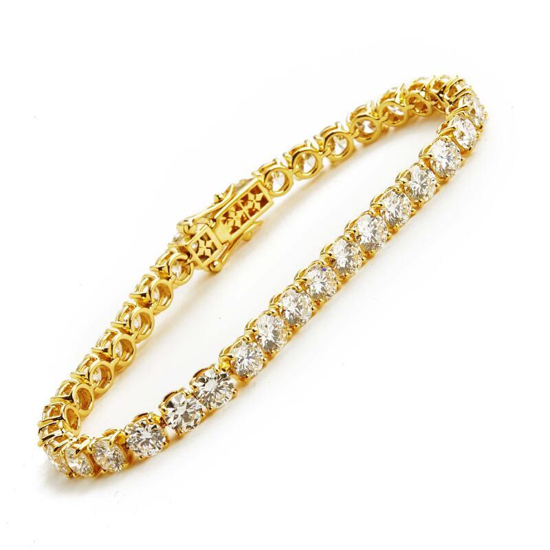 A diamond bracelet set with numerous brilliant-cut diamonds weighing a...