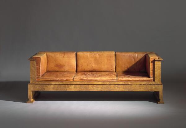 Kaare Klint: An early and unique freestanding three seater sofa with box shaped body of oak burl. Loose cushions with original Niger leather.