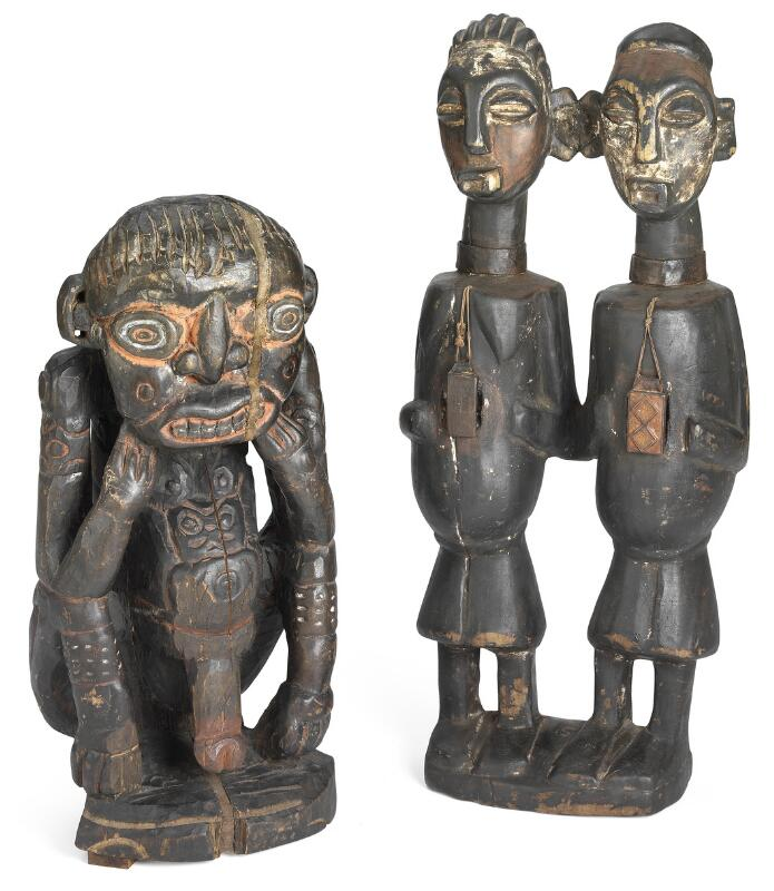 Two ancestor figures of carved patinated wood with traces of red, white and...