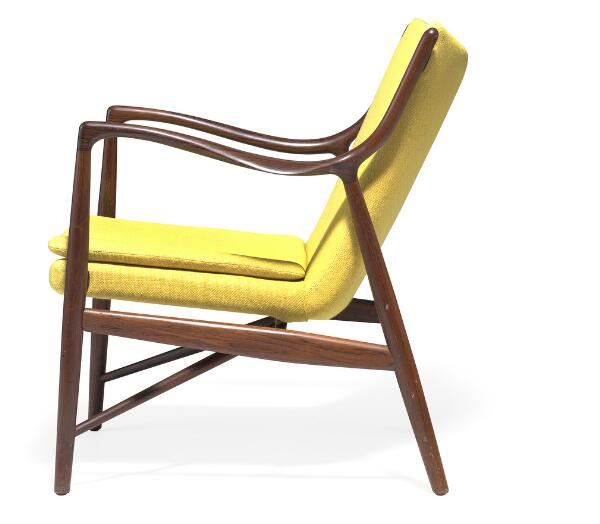 """Finn Juhl: """"FJ 45"""". A Brazilian rosewood easy chair. Upholstered with yellow wool. Made by Niels Vodder."""