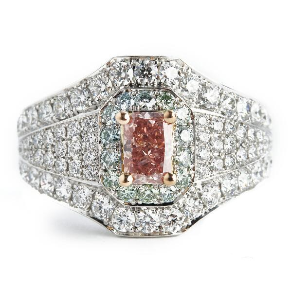 An important pink Argyle diamond ring set with a radiant-cut natural fancy intense pink diamond weighing app. 0.71 ct. and diamonds, mounted in 18 white gold.