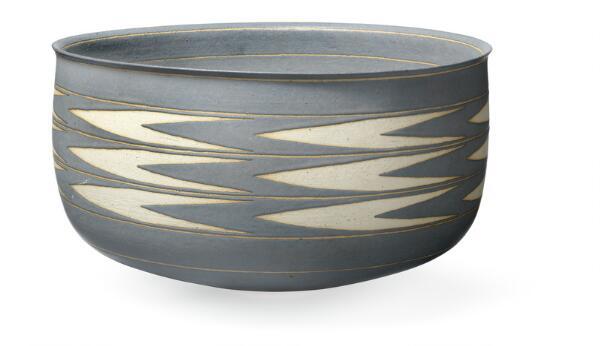 Alev Ebüzziya Siesbye: A large stoneware bowl decorated with greyish blue glaze and with unglazed zig-zag decor.