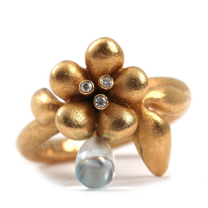 5730ec49ece Ole Lynggaard: A flower ring set with three brilliant-cut diamonds and.