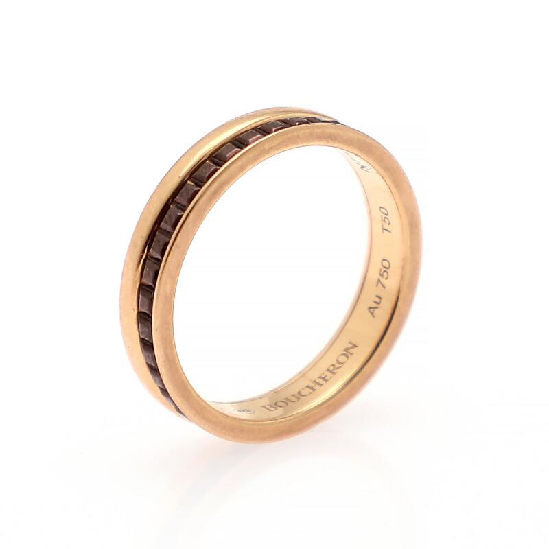 "Boucheron: A ""Quatre Classique"" ring set with brown PVD, mounted in 18k..."