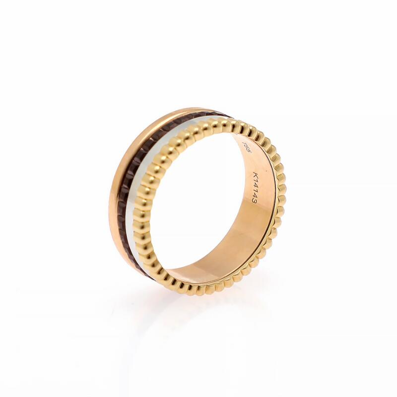 """Boucheron: A """"Quatre Classique"""" ring set with brown PVD, mounted in 18k..."""