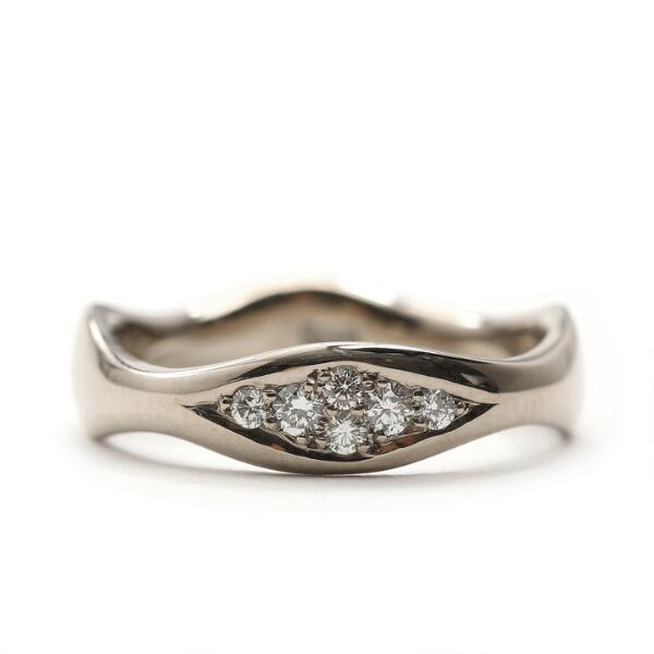 """Toftegaard: """"Wave"""" diamond ring set with brilliant-cut diamonds totalling 0.14 ct., mounted in 14k white gold. W/SI. Size 54."""